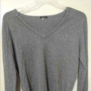 Cute sweater with rhinestone detail on neckline